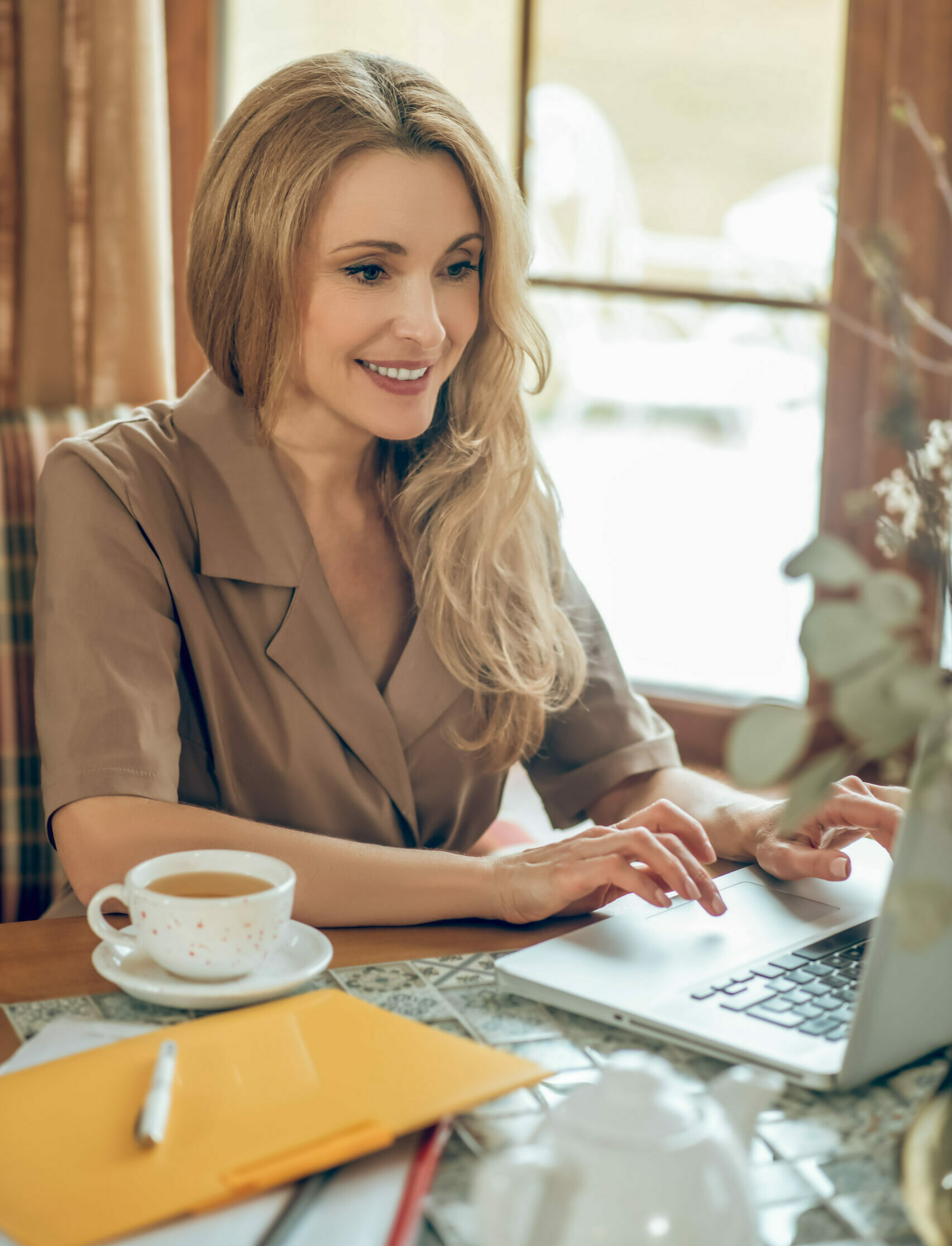 young blonde woman working on taxes for taxact